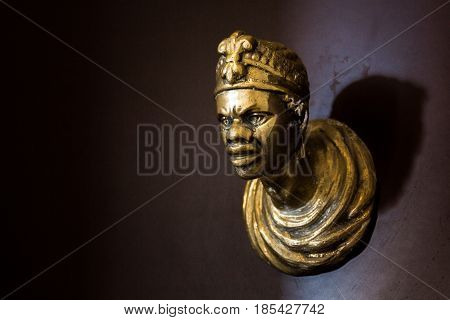Door knob in the shape of the face of an African man. Venice Italy.