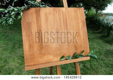Copy space your text here. Wooden easel with a board.