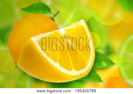 Two whole fruit lemon and slices with leaves