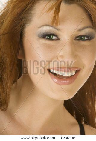 Beautiful Redheaded Woman In Smiling Closeup Portrait 1