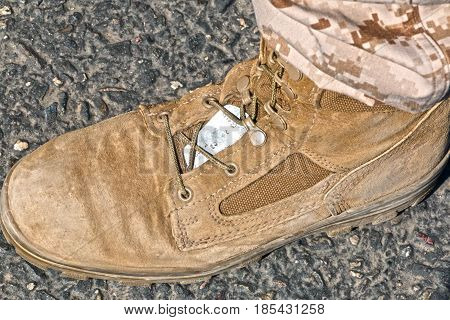 Tan Boot and Tag of a Person in the Military Standing on the Ground
