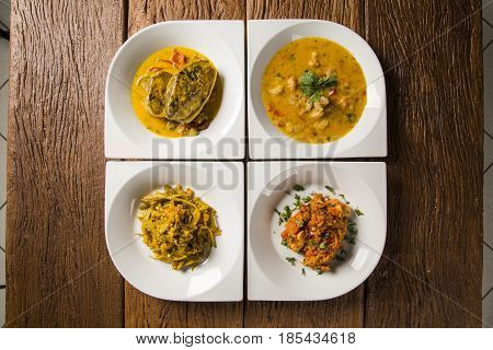 Four Dishes Typical Of Bahian Cuisine - Brazil. Moqueca, Caruru, Shrimp Bobo And Risotto With Octopu