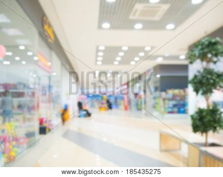 Shopping mall blur background with bokeh. Blurred hall of shopping mall as background.