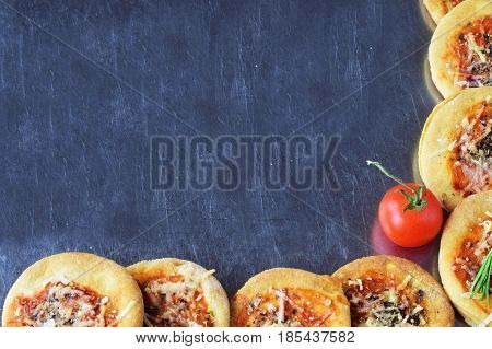 Abstract background with home made biscuits in a form of pizza. space for text. Italian style