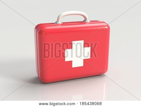 First aid kit. Red doctor's bag with white cross on gray background. Emergency, healthcare, paramedic assistance concept.