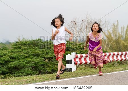 Two Thai cousins with traditional Thai costume