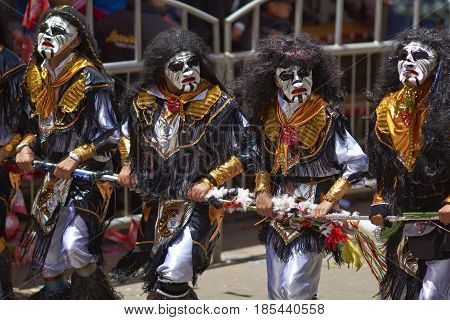ORURO, BOLIVIA - FEBRUARY 26, 2017: Tobas dancers in colourful costumes performing at the annual Oruro Carnival. The event is designated by UNESCO as being Intangible Cultural Heritage of Humanity.