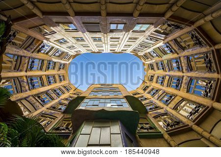 Barcelona, Spain. May 6, 2017: Casa Mila By Antoni Gaudi A View From The Central Courtyard Look Up A