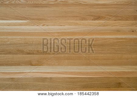 Wooden lacquered table top made of oak wood texture - background