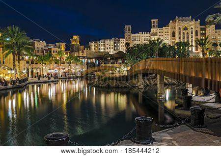 Night view of the artificial canal Souk Madinat Jumeirah on the Arabian Gulf. Dubai United Arab Emirates.