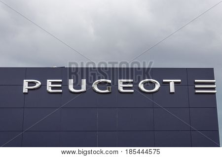 Forli Italy - 26th March 2017: Logo of Peugeot. Peugeot is French car manufacturer. Family business that preceded current Peugeot company was founded in 1810 and manufactured coffee mills and bicycles.
