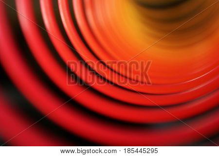 An abstract blur of colorful rings to be used creatively as a design element.