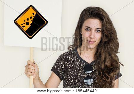 Studio Shoot Holding Banner with Rockfall Beware Sign