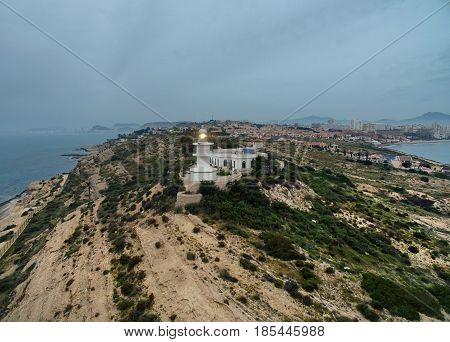 Lighthouse on a hilltop at early morning. Aerial photography. Alicante Costa Blanca. Spain