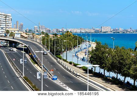 Alicante Spain - April 17 2017: Alicante cityscape. Postiguet Beach and the highway of Alicante city. Alicante is a main resort city on the Costa Blanca. Spain
