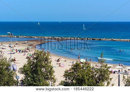 Alicante Spain - April 17 2017: Postiguet Beach of Alicante city. Alicante is a main resort city on the Costa Blanca. Spain