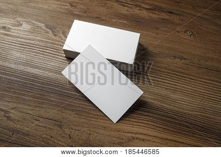 Blank white bussiness cards on wood background. Mockup for ID. Blank template for promotion of corporate identity.