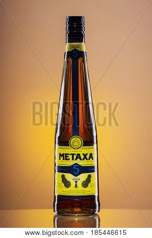 Metaxa on gradient background. Metaxa is Greek spirit based on brandy blended with muscat wine and natural flavorings. It is exported to over 65 countries.
