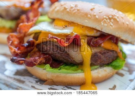 Delicious Bacon Burger with Egg Lettuce and Cheese