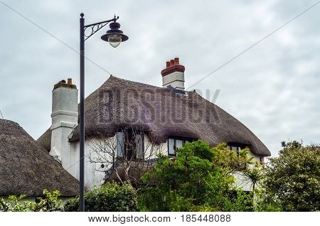 Interesting Structure Of Roofs Of Rural Buildings, Roofs Covered With Straw, Street Lamp, Buildings