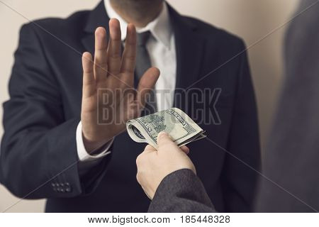 Detail of an honest businessman refusing a bribe money. Selective focus