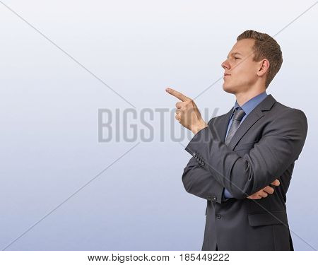 Young businessman with sceptical, critical or analyzing expression.