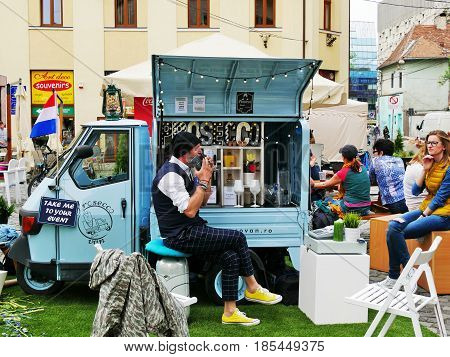 CLUJ-NAPOCA ROMANIA - APRIL 1 2017: Dutch vendor sells Prosecco drinks from his truck on the street.