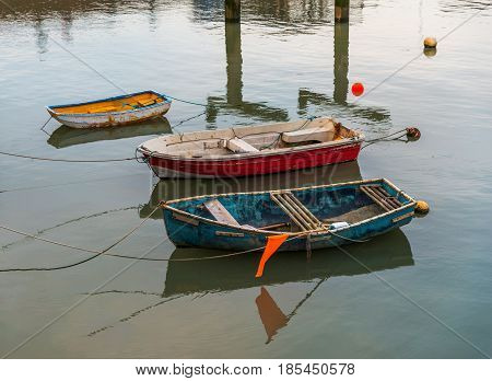 Small Colorful Fishing Boats Moored In A Small Harbor, Water Surface, Coastal Town, Fishing Industry
