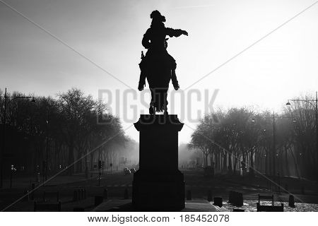 Statue of Louis XIV in front of the palace of Versailles France.