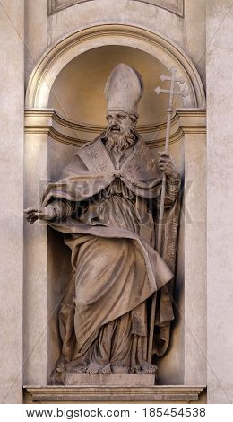 ROME, ITALY - SEPTEMBER 03: Saint Claude by Guglielmo-Antonio Grandjacquet on the facade of Santi Claudio e Andrea dei Borgognoni church in Rome, Italy on September 03, 2016.
