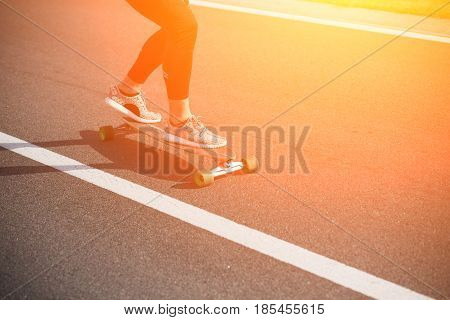 Sportive cool on skateboard or longboard - cool street skateboarder in a urban setting - fashion, sport, lifestyle concepts. Toned.