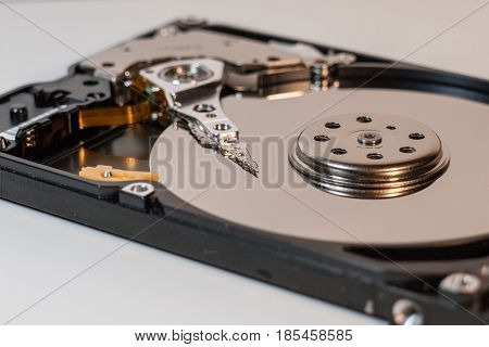 Laptop Harddisk inside with magnetic heads and data store surface