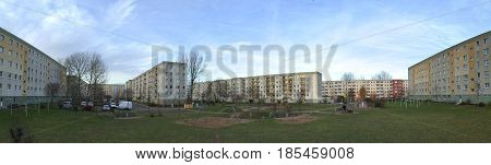 Backyard Of Plattenbau Complex With Playground And Parking Lot In Greifswald, Germany