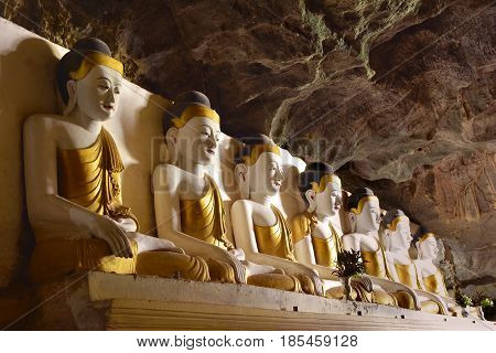 Row Of Buddha Statues Inside Sacred Yathaypyan Cave In Hpa-an, Myanmar (burma).