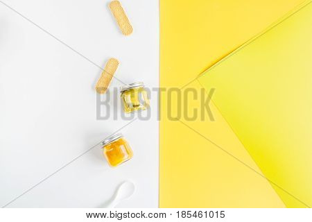 kids desk design with food on yellow and white background top view mockup