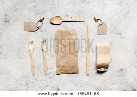 paper bags for food delivery on restourant stone table background top view mockup