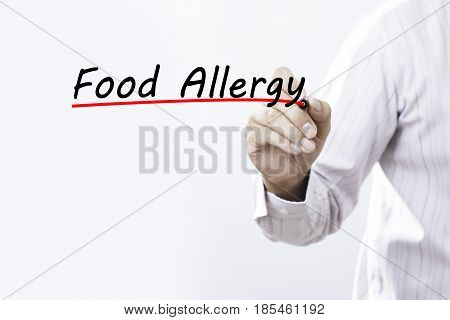 Businessman hand writing Food Allergy with red marker on transparent wipe board business concept.