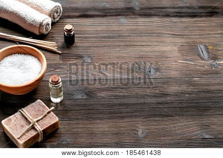 spa composition for body care with sea salt on wooden background mock up