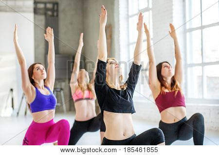 Young girls engaged in stretching at the gym. The concept of sports dance yoga and healthy lifestyle.