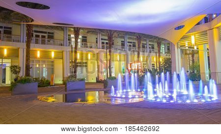Colored blue water fountain and a