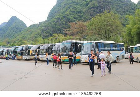 YANGSHOU CHINA - NOVEMBER 19, 2016: Unidentified people visit travel by tour bus in Xingping.