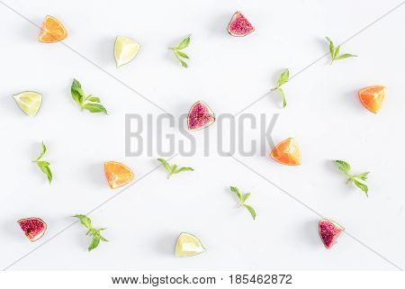 cut fruit pattern with fresh mint on white wooden desk background top view