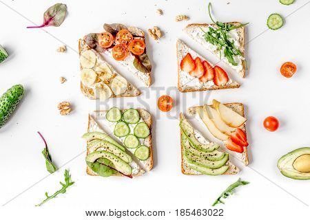 fitness breskfast with homemade sandwiches on white table background top view