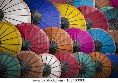 asian umbrellas at the nightmarket in the town of Luang Prabang in the north of Laos in Southeastasia.