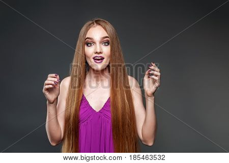 She looks puzzled. Very long hair. The concept model and beauty.