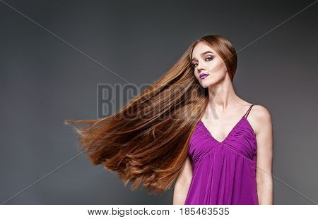 Beautiful girl with very long hair. The concept model and beauty.
