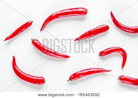 spicy food cooking with red chili pepper on white table background top view