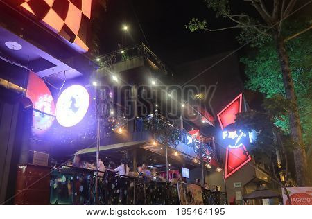 HO CHI MINH CITY VIETNAM - DECEMBER 2, 2016: Unidentified people drink at a bar in downtown Ho Chi minh City.