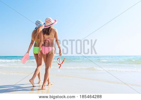 Beach vacation snorkel girl snorkeling with mask and fins. Bikini women relaxing on summer tropical getaway doing snorkeling activity with snorkel tuba and flippers sun tanning. Suntan skin body care.