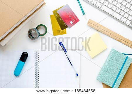 college entrance set with notebook, keyboard and pen on white desk background top view mock-up